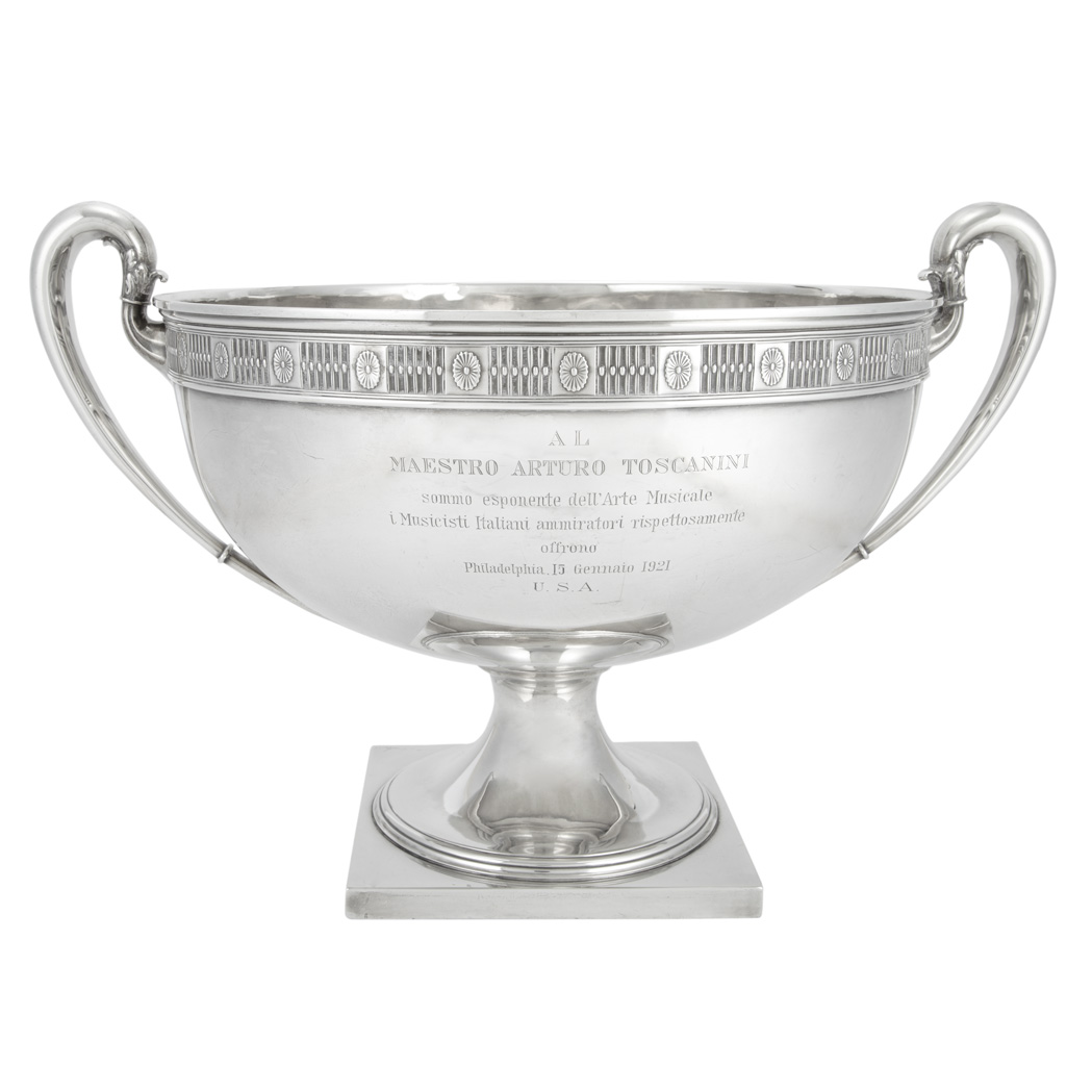 Whiting Sterling Silver Two-Handled Presentation Bowl Bearing inscription to Maestro Arturo Toscanini, 1921. Height 13 1/2 inches (34.3 cm), width 20 1/2 inches (52.1 cm), approximately 136 ounces.