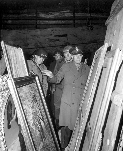 General Dwight D. Eisenhower, Supreme Allied Commander, accompanied by Gen. Omar N. Bradley, and Lt. Gen. George S. Patton, Jr., inspect art treasures stolen by Germans and hidden in salt mine in Germany.
