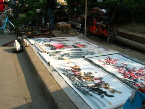 At Di Tan, paintings are displayed on the ground