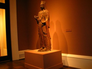 A standing Buddha sculpture in the exhibition