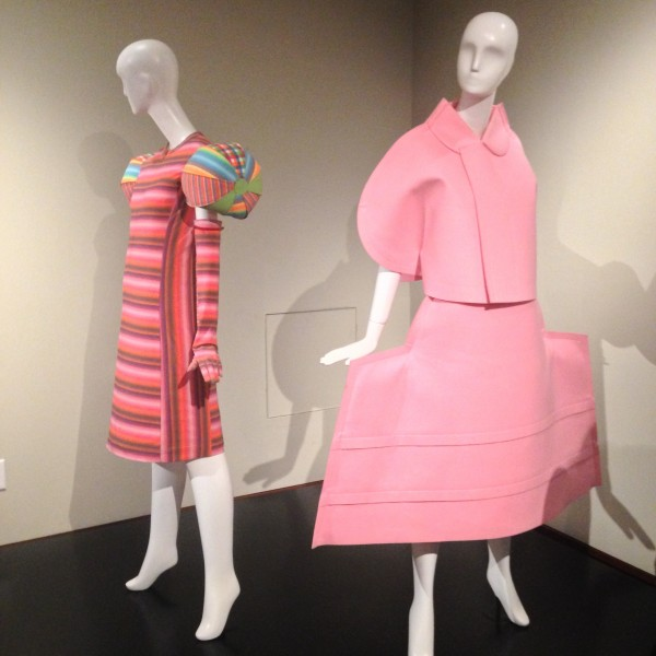 Back: Issey Miyake, Dress, (nylon, polyester, polyurethane) 2001 Front: Rei Kawakubo, Broken Bride Dress (polyester) 2005
