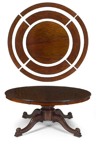 a gigantic Victorian mahogany table with concentric extension