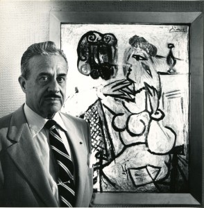 "Raymond Loewy with ""Seated Woman with Red Hat"" (""Femme assise au chapeau rouge"")  Image courtesy of the Hagley Museum and Library © Roy Stevens"
