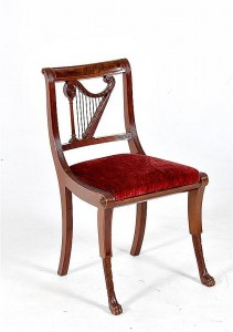 A rare form American harp-backed carved mahogany side chair