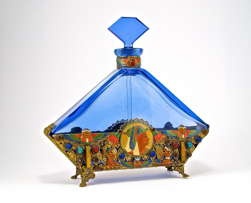 c1930 Czechoslovakian perfume bottle and stopper; blue crystal, dauber; jeweled and enameled metalwork at neck and all around. 7 1⁄2 in.